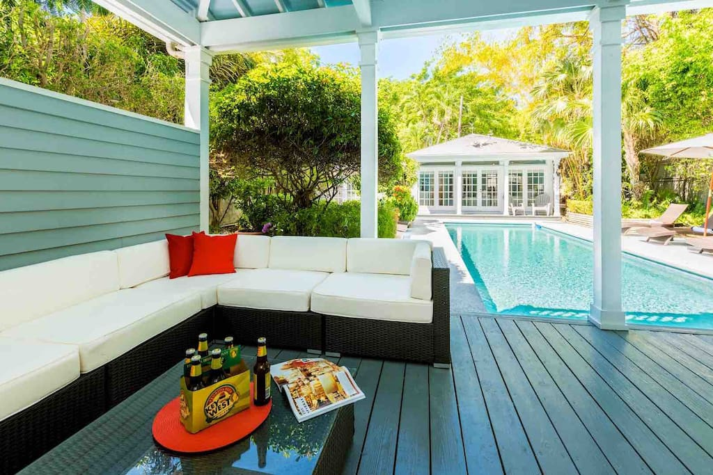 The home has a covered lanai, complete with an outdoor lounge area and bar...