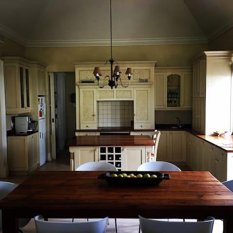 Kitchen with washing machine, dishwasher, tumble dryer, 2 fridges, coffee machine, microwave oven