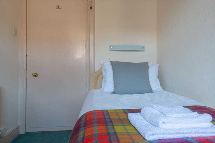 Single bed with comfortable memory foam mattress, wardrobe and black out blinds