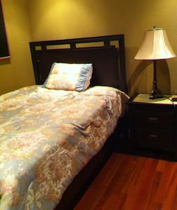 Cozy room with full-size bed. - Coral Springs
