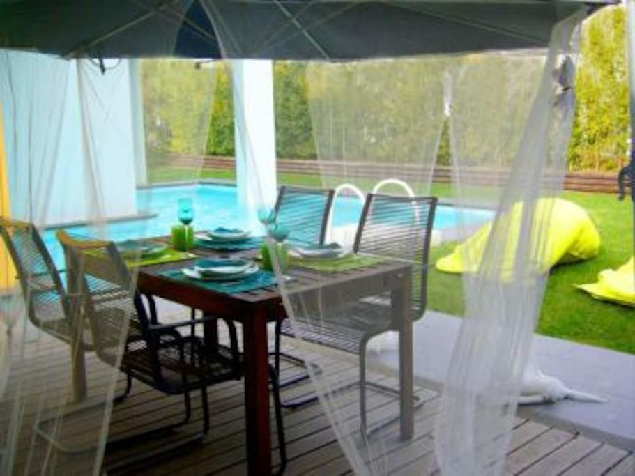 Garden table and swimming pool