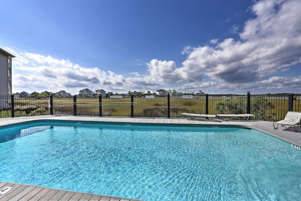 Take a refreshing dip in the community pool before heading to the beach!
