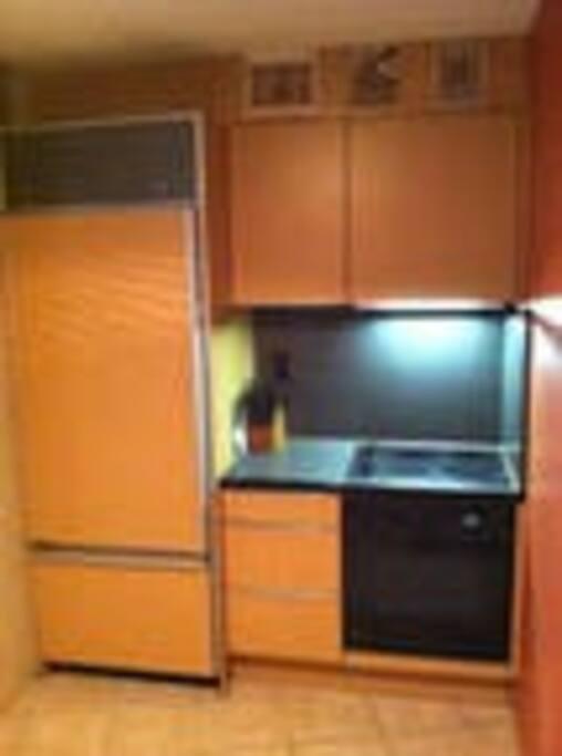 Kitchen has Sub-zero refrigerator, and Wolf stove, mini dishwasher