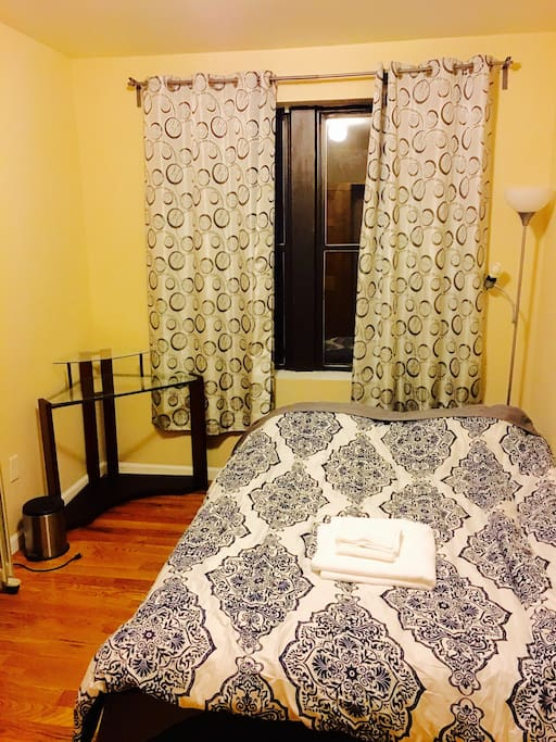 Spacious room with brand new queen bed with memory foam mattress. Has a working desk.