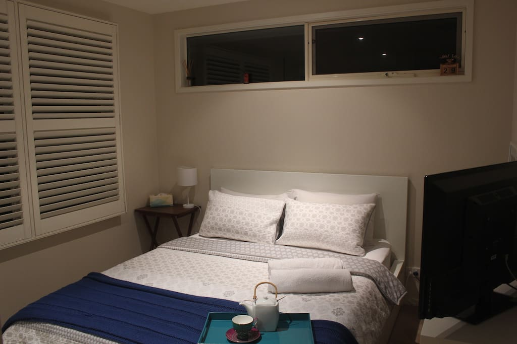 This is your bedroom, featuring a 32cm flat-screen, an apple tv and an evaporative cooling vent overhead