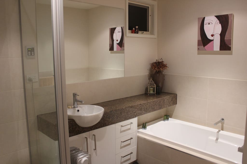 Your bathroom adjacent to your bedroom and sitting area. There is also a separate toilet.