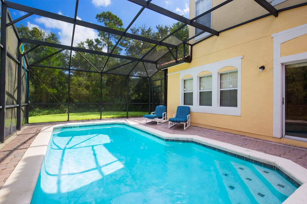 This private and secluded pool deck isn't overlooked and provides the perfect place to soak in the Florida sunshine while here on vacation in Orlando.
