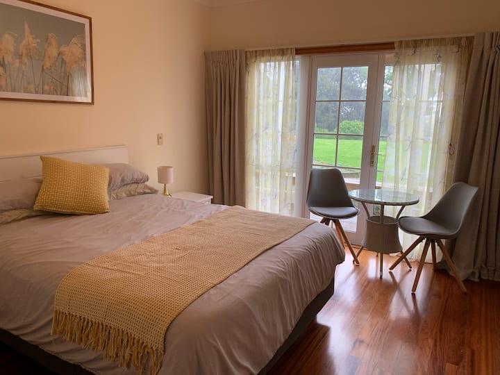 Queen Room with balcony overlooking native bush