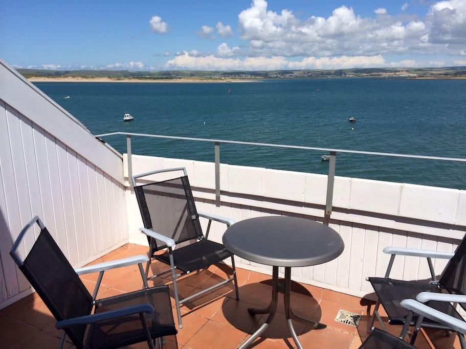 The sunny balcony looking across the estuary to Crow Point