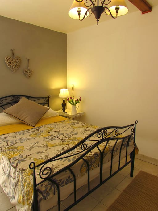 A comfy double bed awaits you after a long day sightseeing