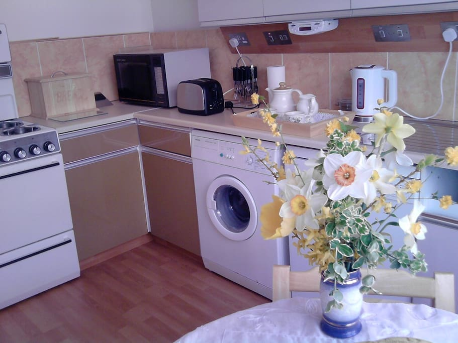 Fully equipped kitchen with room for dining.