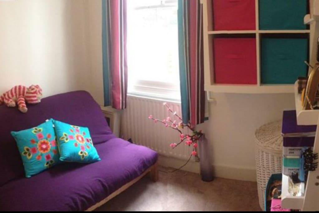 That lovely purple sofa doubles up as a posh futon bed (double). What you can't see is the big wardrobe in there....