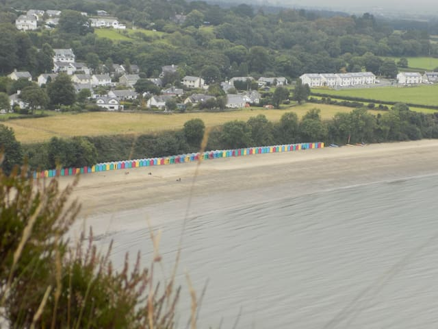 Llanbedrog beach with it's National Trust huts (between April and Sept)
