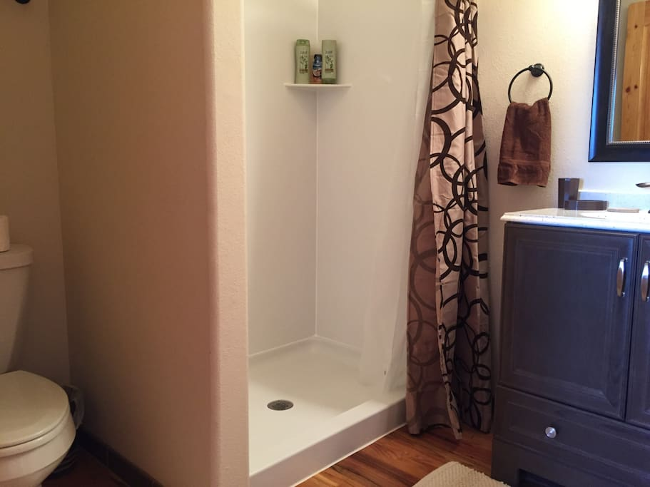 Now with full bathroom! Doored en suite bathroom with toilet, shower, sink and mirror. Towels, hair dryer, shampoo, conditioner, soap provided