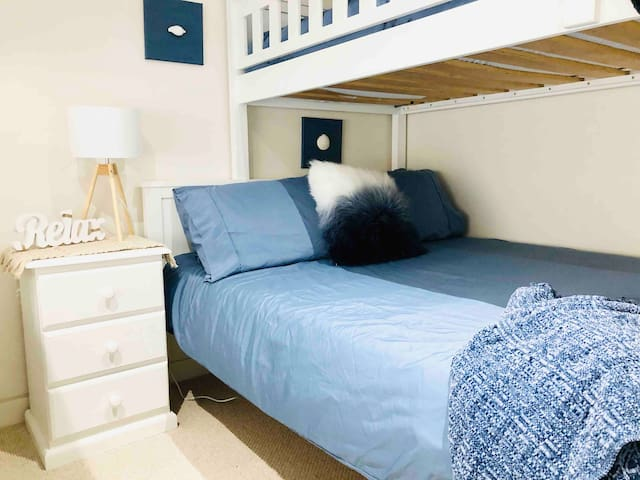 The Ocean Blue Room with a Double bed for a couple. This room has reverse cycle airconditioning for heating or cooling, blinds on the windows, a wardrobe, full length mirror and wall mirror, plus an extra mirror outside the door for a group of ladies