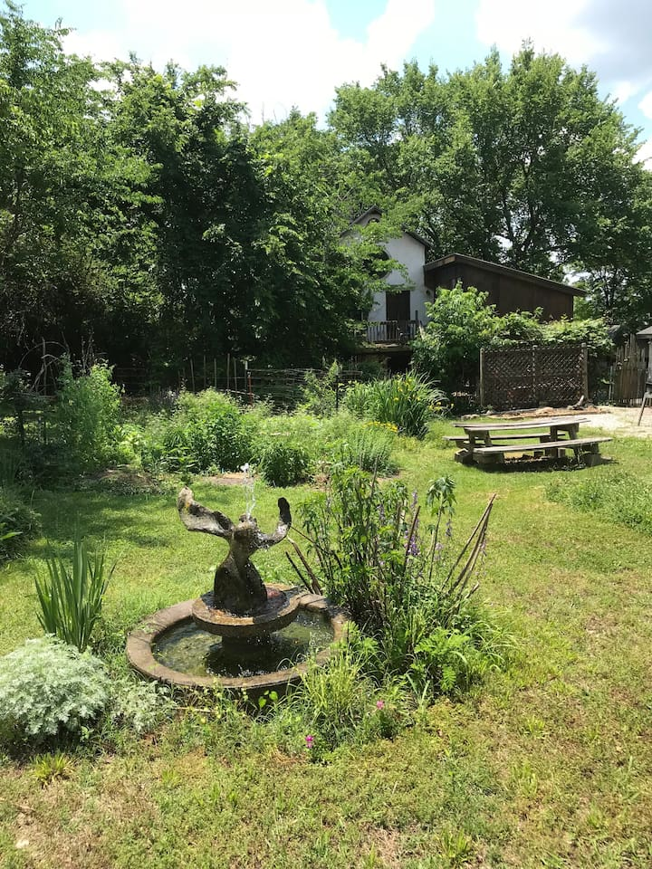 View from the street: fountain,  garden and guesthouse