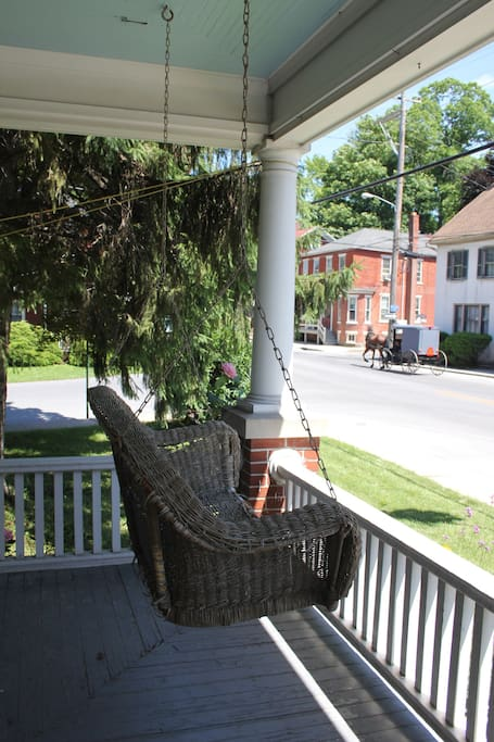 Enjoy the view from the double swing on the front porch.