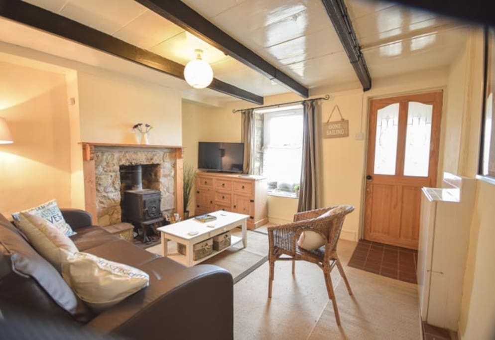 Your warm and cosy lounge with woodburner, Smart TV, and free Wifi.