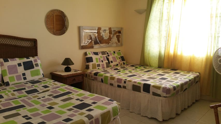 2nd bedroom with 2 queen size beds and  standing fan