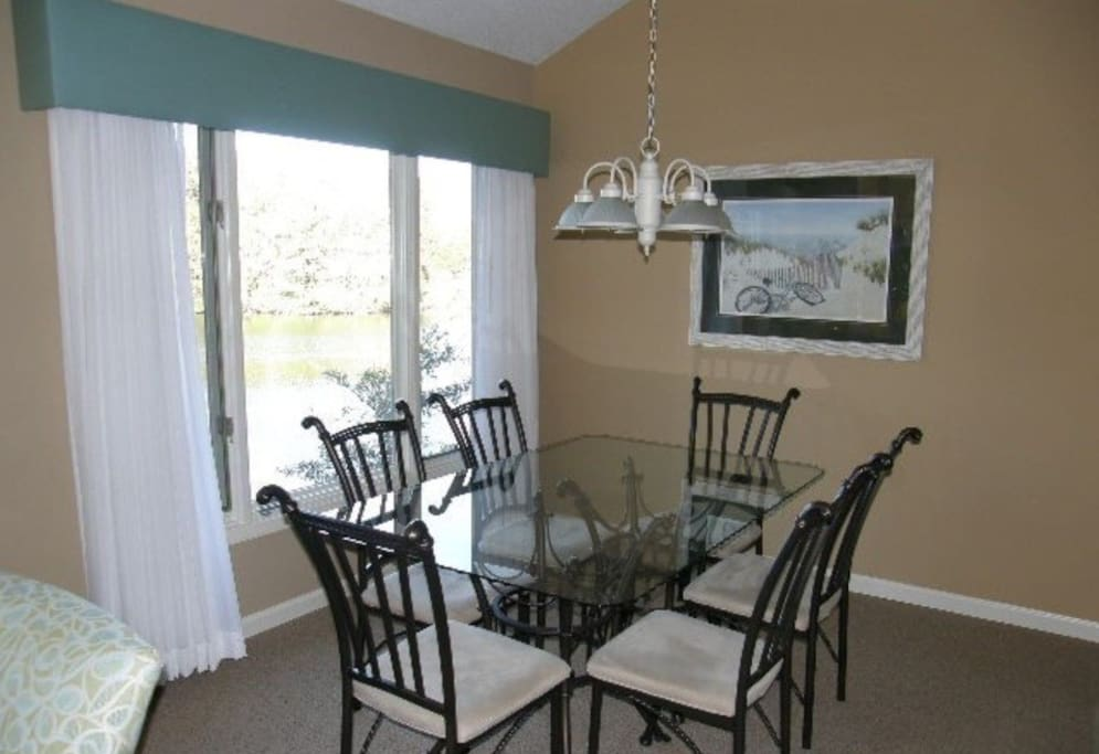 Dining Room with large picture window overlooking golf course