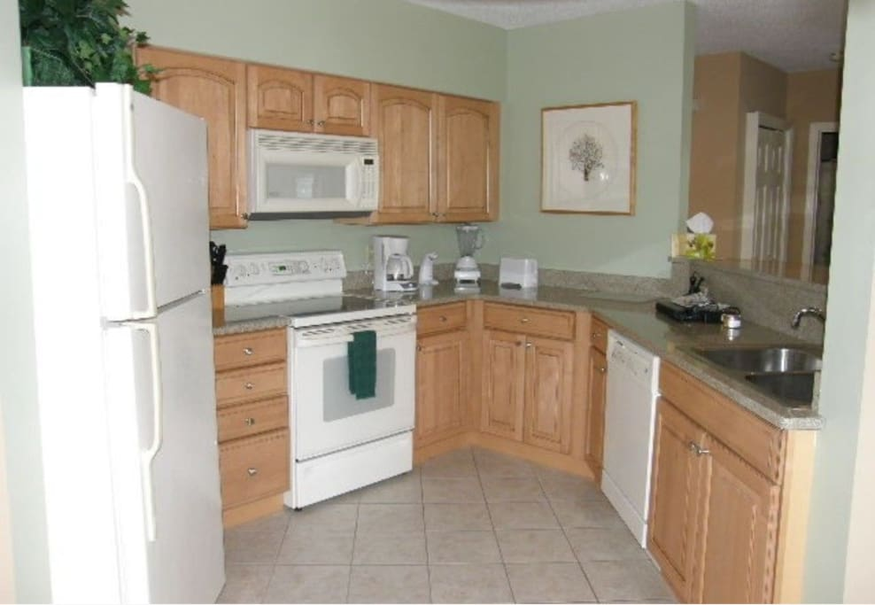 Fully stocked and upgraded kitchen with granite countertops and maple cabinets