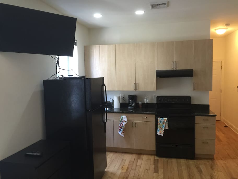 Large screen television with bluray player, many bluray disks. Full kitchen, coffee maker. Four folding chairs and folding table in closet.