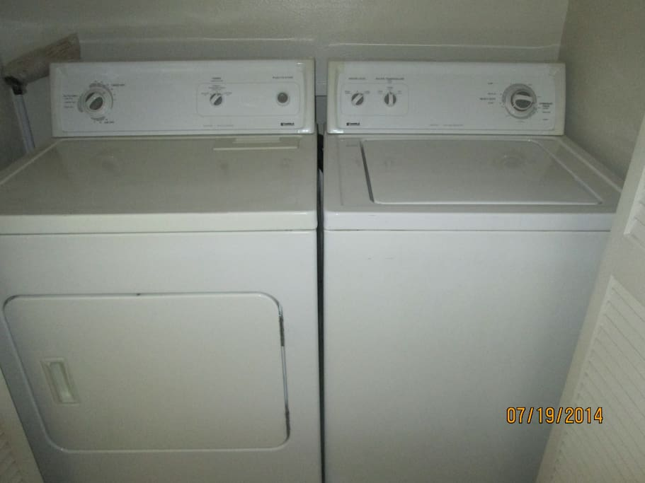 Full size washer and dryer set inside apartment