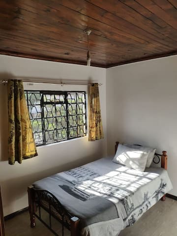 Your bedroom. Comes with white mosquito net with stand and study desk.