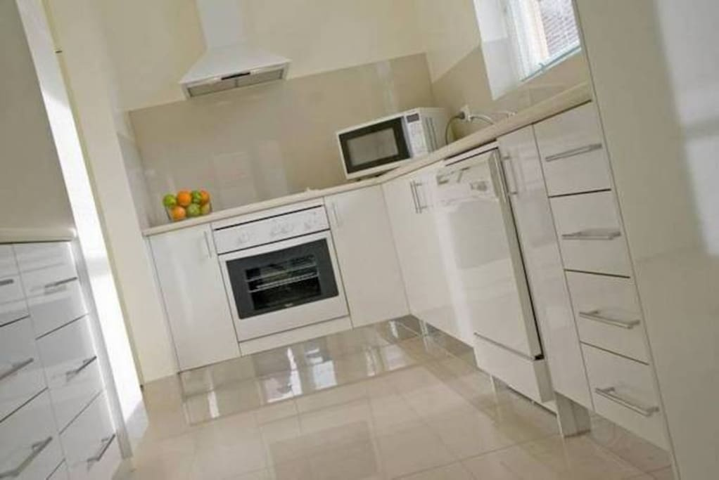 Fully equipped kitchen with everything you need. Including a washer and dryer for your clothes.