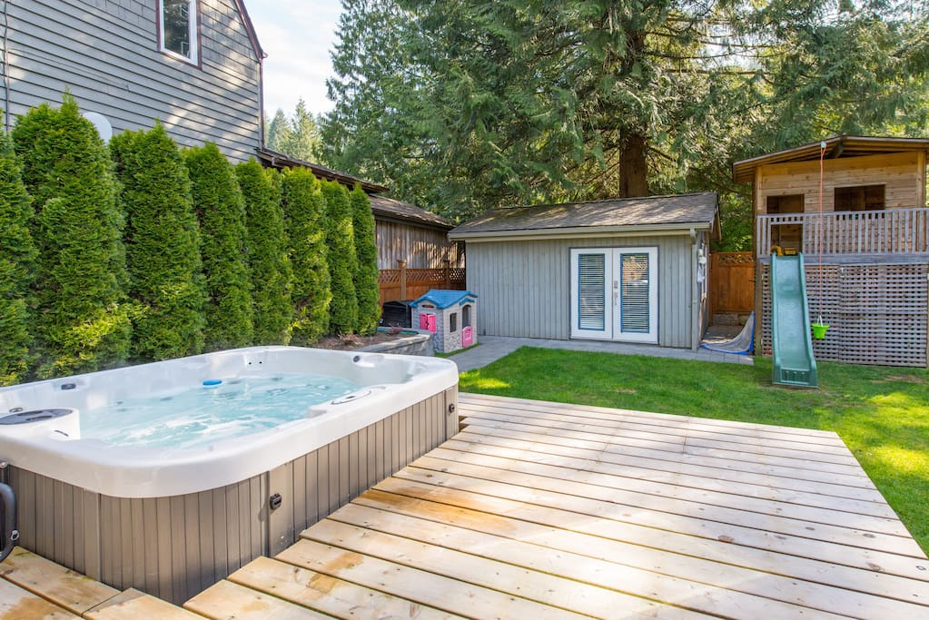 Hot tub off master bedroom deck.  Playhouse is now indoors with a climbing wall, hedges on side have been replaced with fence for added privacy