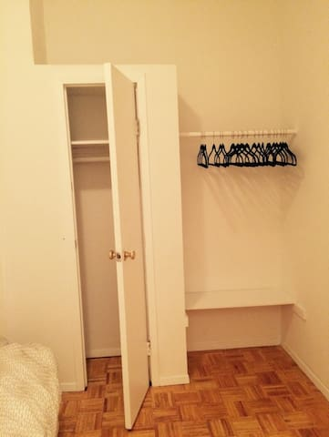Two closets, one with a door, one without.