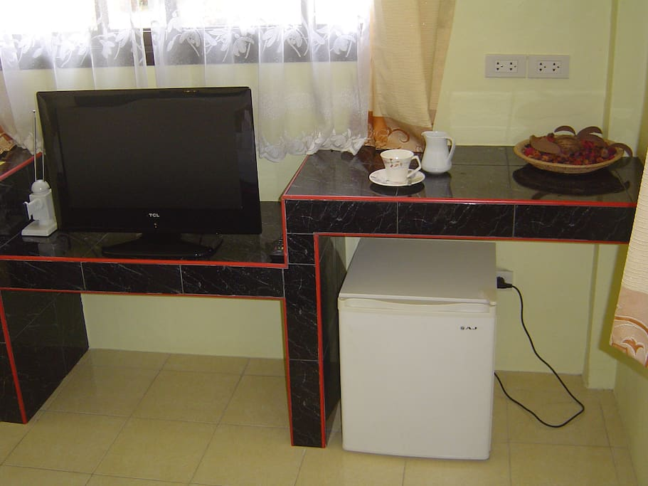 tv with HDMI, fridge and counter