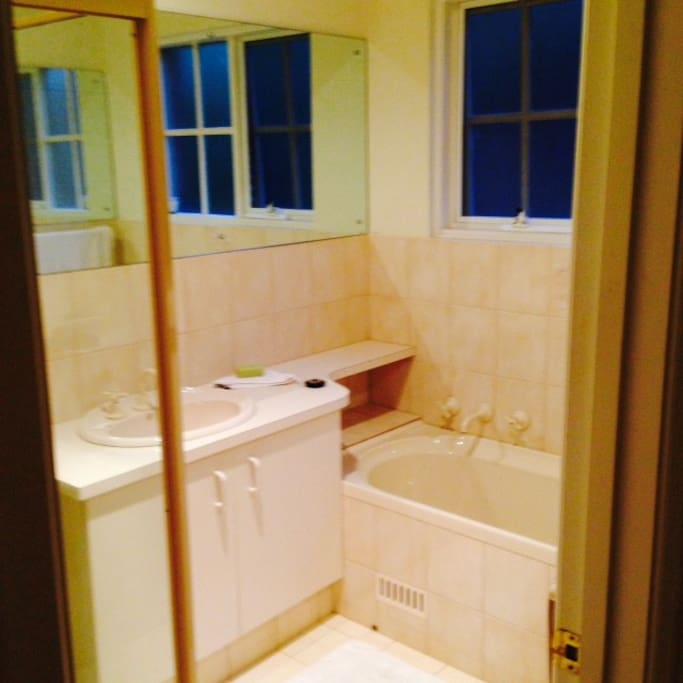 Clean bright bathroom. Toilet next to bathroom is separate.