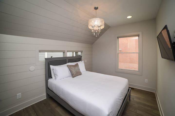 """Unit C: Bedroom 2   2nd Floor. Queen Bed with pillow-top, 43"""" Smart TV, A/C."""