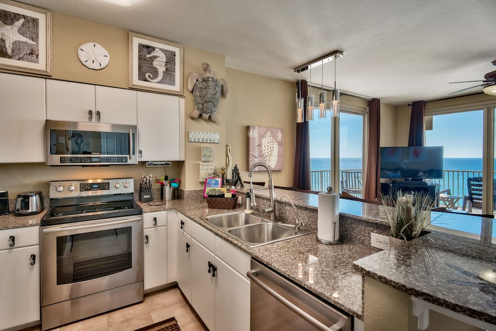 New stainless steel appliances in the fully stocked kitchen
