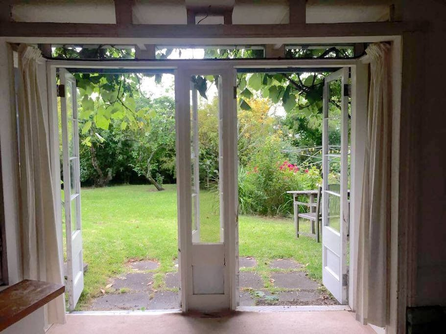 Large leafy garden through double doors