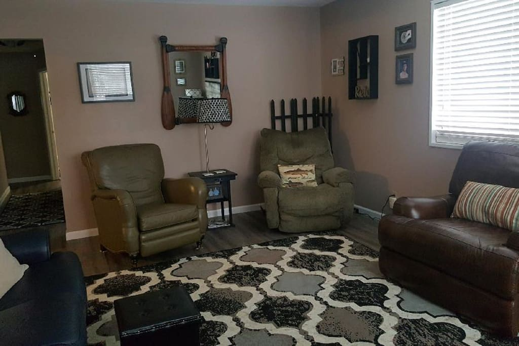 3 chairs and couch in living room