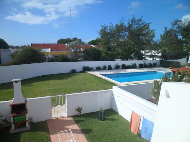 Private garden with large grill place and outside table and common swimming pool