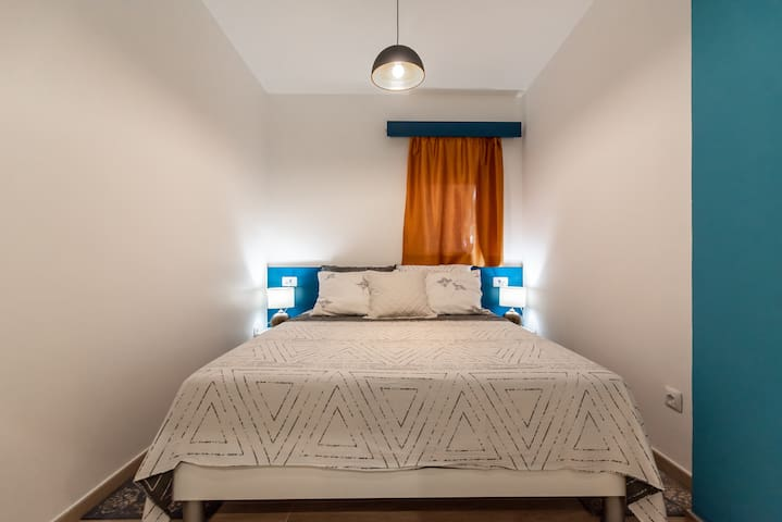 Bedroom and queen size bed.