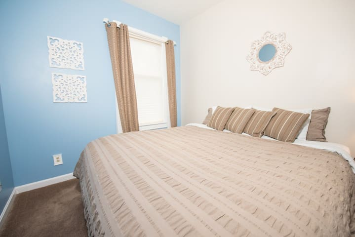 Bright bedroom with king size bed.  Pull the drapes for a tranquil experience.