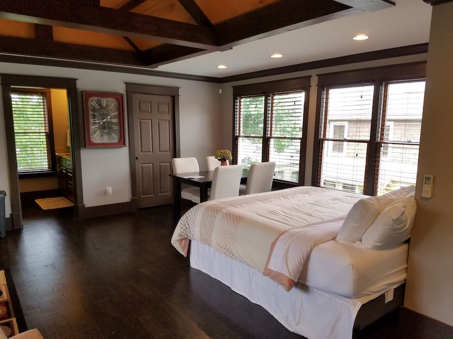 As you walk in you'll have the bed and dining area to your right ...