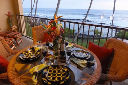 Stunning OCEANFRONT condo in tropical Kona, broad lanai off master suite and living room.  Fully stocked, 2br/2ba, full kitchen, washer and dryer,dining, private sheltered parking, elevator accessible.  Enjoy all that the Big Island has to offer!