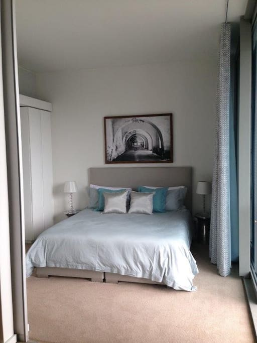 Spacious main bedroom with king size bed, lots of cupboard space and ensuite elegant bathroom with big tub bath and glorious shower