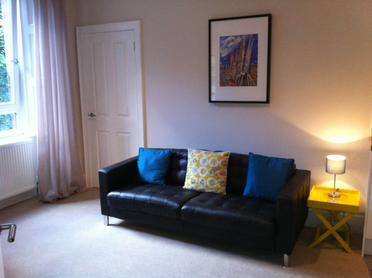 Sunny, well furnished and comfortable lounge.