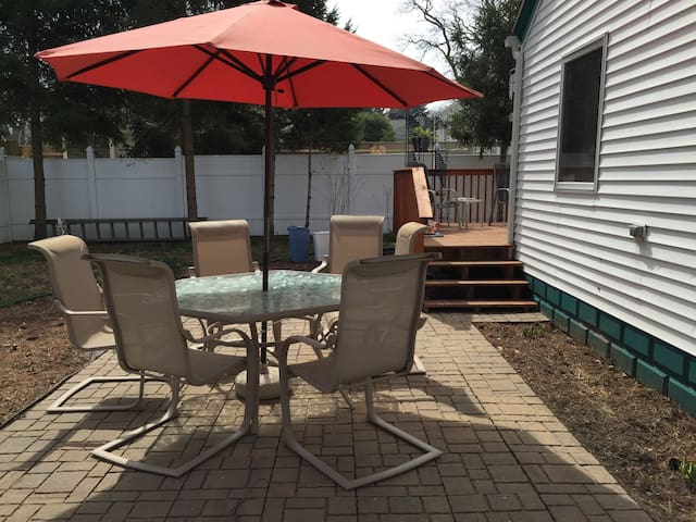 Fenced in backyard, patio and deck. Fire pit and grill included.