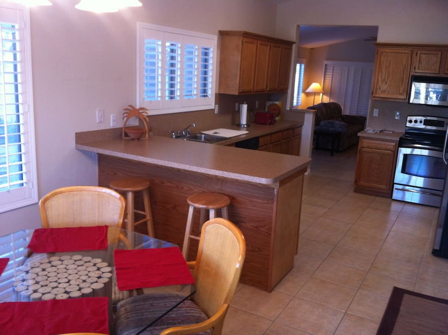 HUGE kitchen with BRAND NEW stainless steel appliances.