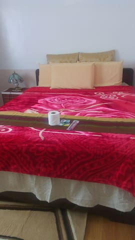 Bed with another variation of blanket