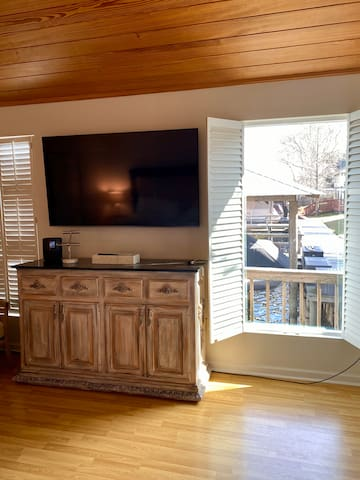 """Master Bedroom w/65"""" TV"""