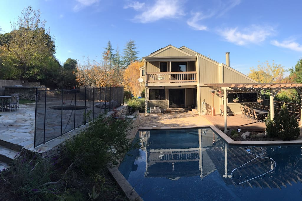 Backyard retreat with pool, deck, upper patio and BBQ
