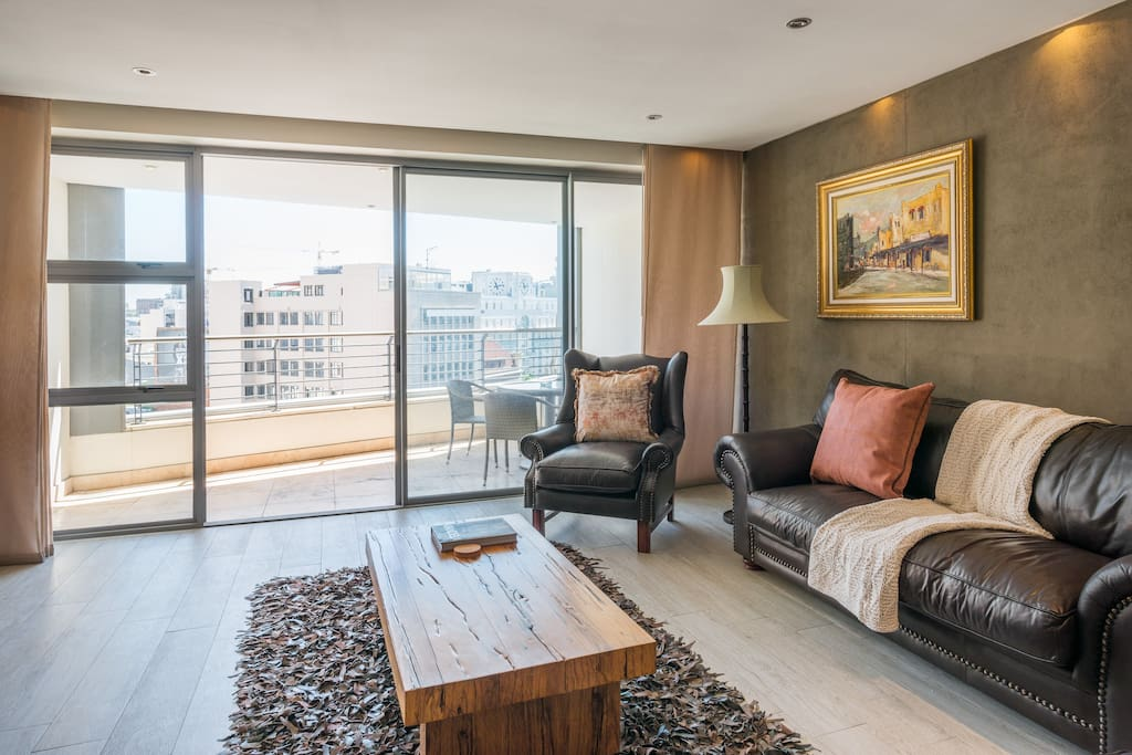 Comfortable living-room that leads onto the large private balcony.